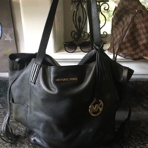 Authentic Michael Kors black leather bag.
